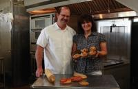 Man and woman display baked goods