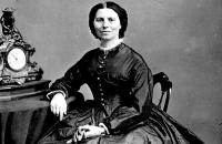 Photograph of Clara Barton sitting at a desk.