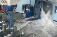Water floods a train station.