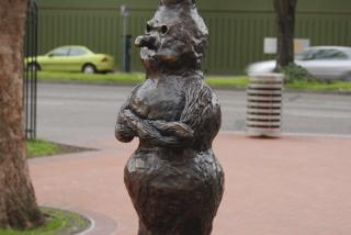 An old woman sculpted from a burl