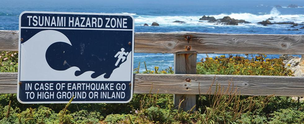 Tsunami sign on coast warning residents  to seek higher ground