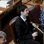 Josh Savey sits in the chambers of Oregon government.