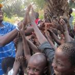 Richard Kitumba greets a crowd of Congolese children