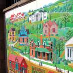 A colorful mural adorns a brick building
