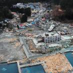 Aerial photo of a navy yard devastated by a tsunami