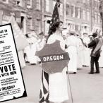 A suffragist holds an Oregon shield and a U.S. flag