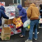 Community members select donated produce.