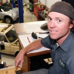 Zach Edwards sitting at a desk in his auto shop